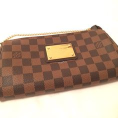 Louis Vuitton Eva Clutch LOUIS VUITTON EVA CLUTCH. Damier Ebene canvas with gold hardware. Comes with a detachable leather strap. This bag is very versittle - it can be worn as a clutch, shoulder bag, or over the shoulder bag. 100% AUTHENTIC - GUARANTEED! The bag and strap are in EXCELLENT CONDITION. Minor exterior scuffs and marks on the hardware plate. No rips. No smell. No stains. PAYPAL INVOICE only (for a secured, worry-free transaction. EMAIL ME FOR PRICE INQUIRIES! Please contact me…