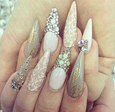 Gaudy stiletto nail designs