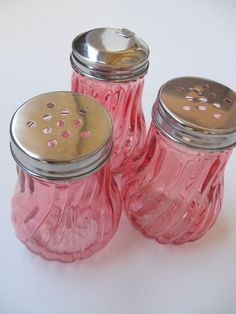 Vintage Pink Sugar Shakers. Would use these to store trinkets or something in my bedroom... :)