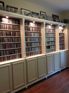Dvd Shelf Ideas an old door hides the music away. brilliant! although would be