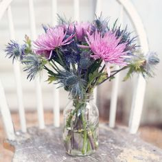 Purple & Blue, Rustic Centerpieces // SayBre Photography // Flowers: Bloomin Bouquets // http://www.theknot.com/weddings/album/a-garden-charm-wedding-in-lilburn-ga-133437