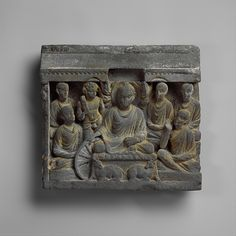 The Buddha is shown teaching the first sermon to five ascetics who become monks; in this way, he establishes the monastic order. The Buddha reaches down to set in motion the wheel of the law—a well-established symbol of Buddhist teaching, or dharma. Buddha's First Sermon at Sarnath  Date:2nd century Culture:Pakistan (ancient region of Gandhara) Medium:Gray schist Dimensions:H. 11 1/4 in. (28.6 cm); W. 12 1/4 in. (31.1 cm); D. 2 in. (5.1 cm) Classification:Sculpture