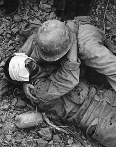 W. Eugene  Smith      WORLD WAR II.  //  The Pacific Campaign. April 1945. The Battle of Okinawa (Japanese island).