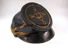 """McDowell"" pattern forage cap of cadet gray wool; four rows of wide gold thread braid around the band; two strands of gold braid on the front, back, and sides of the ..."