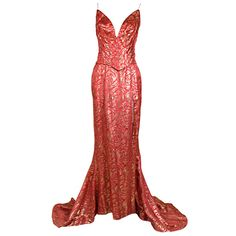 Evening Dress: 1950's, metallic Deco floral brocade, sculpted waist, exaggerated princess seams, long skirt with lavish train and revealing side slit.
