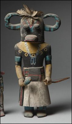 A Hopi Polychrome Wood Kachina Doll, depicting Ahote Estimate 10,000 — 12,000USD LOT SOLD. 25,000 USD height 13 in.