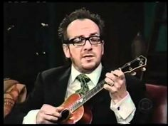 """Elvis Costello. The song was featured in the movie, """"Cold Mountain."""""""
