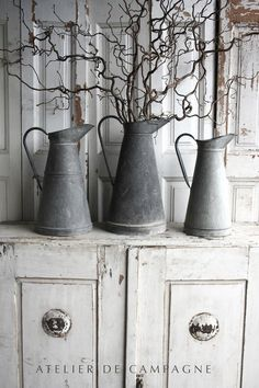 curly branches, zinc pitchers, whitewashed wood