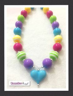 Our Sweet Heart Rainbow Bubblegum Bead Necklace with teal, purple, yellow, green and pink beads and featuring a teal coloured heart pendant is just $16.50 including shipping (untracked) anywhere in Australia. More designs available at www.bubblegumroyal.com