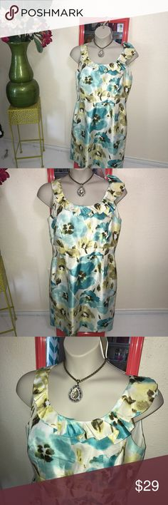 Alex Marie sleeveless floral garden dress EUC  14 Alex Marie lightweight sleeveless dress size 14 in aqua and chartreuse colored flowers, feels like silk material but easy to care for wash and wear. Cute ruffled collar make the stress unique also it features a waistline and a straight skirt very flattering for curvy figures. Great for a wedding, shower, her church anywhere that you want to dress up! Save money when you bundle purchase from my closet! Alex Marie Dresses Midi