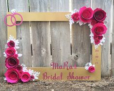 Your event deserves unforgettable photographs, and this fine art photo frame is the way to make that happen. I handcraft this frame with meticulous attention to detail, and I match your vision for the perfect product. This particular listing has 3D hand-made roses in Hot Pink and Magenta. They are gorgeously surrounded by white leaves, and there is a custom message in glitter pink, as well as glitter pink wedding rings in the upper left hand corner. Message me to see this frame in your…