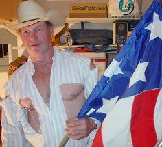 fighting texan man torn shirt ripped pants