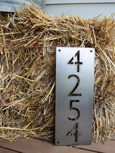 • All of our metal signs are hand cut by a CNC plasma machine. • Size Approximately : 14.5 H x 4.5 W - 3 Numbers 20 H x 4.5 W - 4 Numbers (Shown) 23.5 H x 4.5 W - 5+ numbers Height varies based on Amount of Numbers • This is a custom metal address sign. It has precut holes for easy installation, and made from steel. This product is personalized with your own house number and will make a great addition to any front porch or mailbox. Items pictured are raw steel. Additional options are…