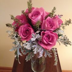 Wildrose Floral Design Wedding Gallery. Lavender and Silver - Roses and Dusty Miller are featured in this elegant brides maid or bridal bouquet with coordinating silver satin ribbon and pearl sleeve. Additional sizes and colors available. Contact at wildrosefloraldesign.net or check it out on Facebook.