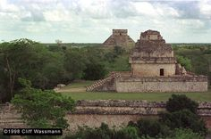 Merida, Mexico--Explored fascinating archeological ruins.Chichen Itza, Observatory, fore ground, El Castillo background