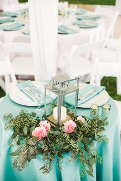 In case you don't know, I LOVE seeded eucalyptus. Paired with cheery pink carnations and a candle lantern, it gives this wedding centerpiece a lush, organic feel.