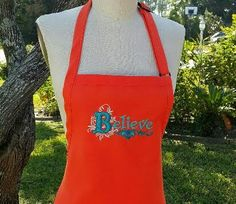 Orange apron with teal embroidery thread / Believe Apron / Hostess gift idea /Elegant apron/ Personalized apron / Womens apron . by SouthernA on Etsy