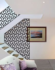 white stairwell with organic circles screens and laser cut panels