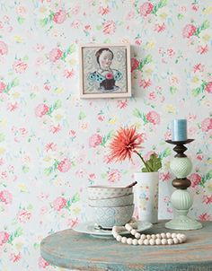 Wallpaper Design 'La vie en Rose' reference 3900020 (10 metres x 53cms) Room Setting! A beautifully designed floral wallpaper in a delightful array of bright colours on a subtle blue background. This wallpaper is washable, with good light resistance and strippable.