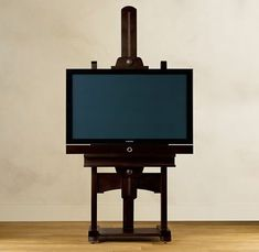 Carm just ordered this TV easel from Restoration Hardware ; the home is becoming tres chic
