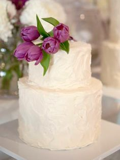 A purple tulip buttercream wedding cake