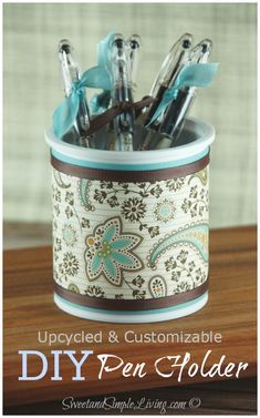 DIY Pen Holder - I made this from an empty frosting cup and decorated it up!  Recycle baby!