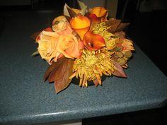 Warm hues of fall featuring roses, callas, chrysanthemum, berzillia, peony foliage. Arrangement by Christine March, Imprint Wedding Design & Coordination, Toronto.