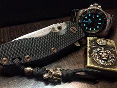 Rolex Deep Sea Dweller, Zippo Custom, Hinderer XM18 Custom.