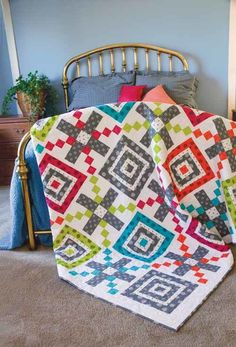 Big Time Quilt Kit: This quilt sews up so quickly, thanks to the large, easy-to-piece quilt blocks in bright and happy colors. Kit includes vibrant prints from the Go Big or Go Home collection from Windham Fabrics.