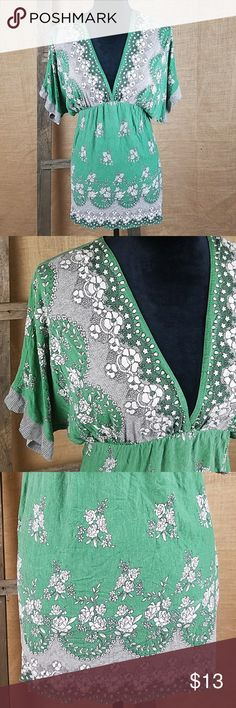 """Anthropologie Lux women short sleeve high waist Anthropologie Lux women short sleeve high waist floral shirt green, 100% rayon.  Gently used, missing the size tag please check for measurements. Looks like medium   Length: 35"""" Waist side to side: 17"""" Anthropologie Tops Tunics"""