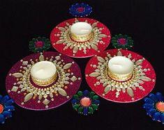 pink red or purple Kundan Rangoli Mandala decor Table by CozMHappyTealight holder baseDiwali diya temple accessory boho by CozMHappyTealight candle holderBollywood party favors Diwali by CozMHappyBrowse unique items from CozMHappy on Etsy, a global m Purple Candle Holders, Purple Candles, Tea Light Candles, Tea Lights, Diya Decoration Ideas, Diy Diwali Decorations, Tree Wedding Centerpieces, Diy Centerpieces, Old Cd Crafts