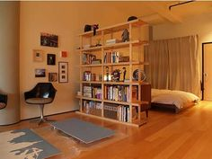 Apartment,Modern Small Apartment Interior Design Ideas With Laminated  Wooden Flooring And Wooden Bookshelves Room Divider Featuring Charming Low  Bed And ...