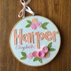 This Hand-Embroidered Hoop Art uses customized names and flowers to add a modern vintage accent to your child's bedroom. The words are appliquéd and hand-stitched with colorful cotton embroidery floss, and the flowers are created with wool blend felt for an attractive raised 3D effect. The background fabric will complement your beautiful one-of-a-kind piece. Your Hoop Art will make a lovely birthday or baby gift. All hoop art is finished with a felt backing and a matching ribbon or yarn…