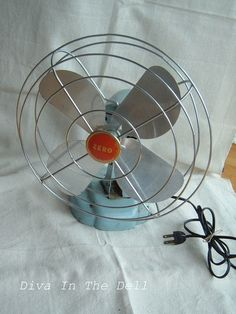 Vintage blue and orange Zero metal fan