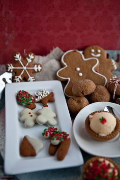 Gingerbread Cookies:  3 1/2 cups flour, 1 tbs ground ginger, 3 tsp ground cinnamon, 1 1/2 tsp baking soda, 1/2 tsp ground cloves, 1/2 tsp freshly grated nutmeg, 1/2 tsp salt, 3/4 cup dark brown sugar, 1/2 cup butter (softened), 2 eggs, 1/4 cup molasses; To decorate - granulated sugar, candies, icing, frosting, chocolate for melting
