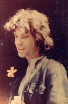 Snapshot of Jim with a yellow flower