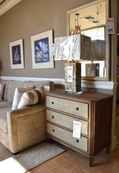 3-drawer chest with linen textured drawer fronts makes a perfect end table, and it's paired here with one of our favorite mirrors. Mirror has an interesting antiqued finish.