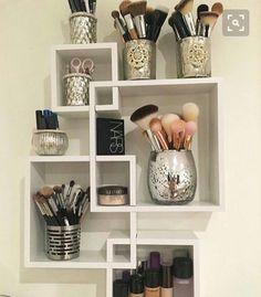 Elegant mercury glass holders on geometric shelving piece. Organization, chic, classy, bathroom, bedroom, makeup, vanity.