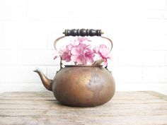 This lovely little copper tea kettle is the perfect addition to any rustic or country kitchen! It measures about 6.5 in diameter and 8 tall