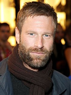 Aaron Eckhart - He just has something that works for me.  I love his voice.