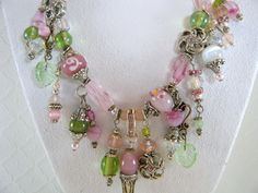 Chunky Necklace Statement Necklace  Beaded Cluster Necklace Charms Pink and Green Jewelry Lampwork Necklace. $75.00, via Etsy.