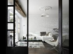 dark wood floors and all white walls