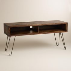 Full of mid-century modern appeal, our mid-height media console features metal hairpin legs and an acacia wood top distressed for a reclaimed feel. Pair with our coordinating coffee and end tables for mod-inspired style in your living space.