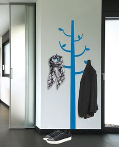 Great way to get a coat rack and utilize an empty wall while saving precious space all at the same time!