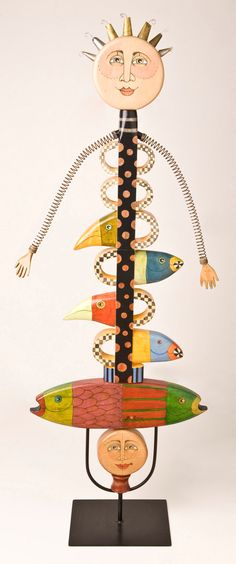 amazing stacked fish and bird assembled art angel totem love the face and knobby hair...