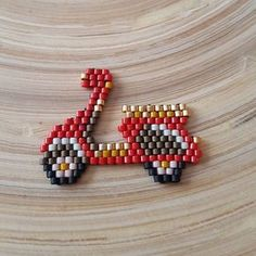 Scooter from perler/aqua beads Beaded Crafts, Beaded Ornaments, Jewelry Crafts, Seed Bead Projects, Beading Projects, Peyote Patterns, Beading Patterns, Bijoux Diy, Pony Beads