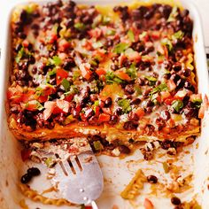 Deliciously decked out with layers of garlicky noodles, crisp veggies and lush cream cheese, our fabulous black bean casserole is the perfect excuse to throw a fiesta! http://www.bhg.com/recipes/casseroles/freezer-ready-casseroles/?socsrc=bhgpin122714blackbeanlasagna&page=13