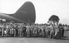 Feb. 12, 1945... A makeshift runway was cleared on one of the broad streets north of Santo Tomas and this Curtiss C-46 landed to evacuate these liberated nurses first to Leyte then by ship back to the USA.  This photograph is from the National Archives and Records Administration of the USA..    www.archives.gov/