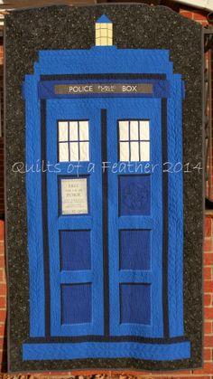 """Very cool quilt by @Renee Peterson Peterson Hoffman from Quilts of a Feather! She designed, pieced and quilted this fantastic Tardis II quilt when she could not get Tardis printed panels any longer.   """"The final size of this quilt, after washing, is 39"""" x 71"""". I used two layers of Warm and Natural for extra weight and texture in the quilting. I used #Aurifil #2740 (royal blue) for most of the quilting on the TARDIS."""""""