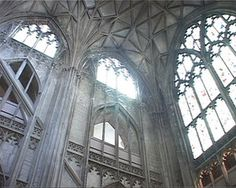 Gothic windows at Gloucester Cathedral. After the great flowering of Gothic style, tastes again shifted back to the neat, straight lines and rational geometry of the Classical era.